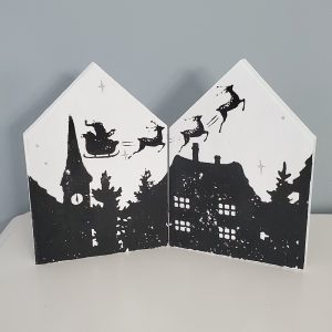 Santa flying over rooftops art